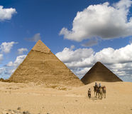 Cheops Visitors. Tourists on the way to Cheops Pyramid in the Egyptian Sahara royalty free stock photography