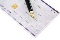 Cheque. And pen royalty free stock image