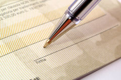 Cheque. Signing cheque closeup. A series Royalty Free Stock Photos
