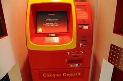 Cheque ATM Machine. A single cheque ATM machine in the wall Royalty Free Stock Photos