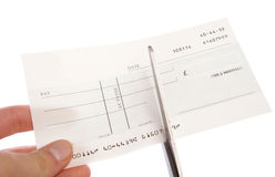 Cheque being cut up cutout Stock Image