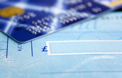 Cheque Book & Card. Cheque Book and Card Close up with Depth of Field Effect. Focus on the Pound Sterling sign on Cheque stock photography