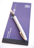 Cheque book and pen. Royalty Free Stock Photography