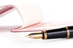 Cheque con la pluma Fotografía de archivo libre de regalías