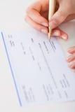 Cheque de firma de la empresaria Imagenes de archivo