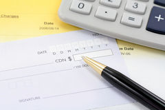 Cheque with pen Royalty Free Stock Photography