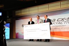 Cheque presentation during launch of Mazda CX-5 Stock Images