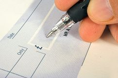 Cheque signature Stock Image