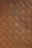 Chequer plate metal. Vertical shot of some old rusty checker plate metal royalty free stock photo