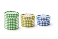Chequer round gift boxes. Of various sizes on white background royalty free stock photo
