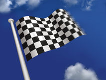 Chequered flag flying. Chequered flag with blue sky in the background Royalty Free Stock Photography