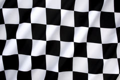 Checkered Flag - Win - Winning. Checkered Flag - traditionally used in auto racing and similar motorsports to indicate the end of a race. The first past the Stock Images