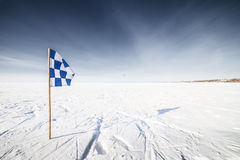 Chequered flag in Winter landscape Royalty Free Stock Images
