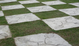 Chequered Floor. Malacca - December 2011 Chequered floor, alternating between concrete tiles and grass patch royalty free stock photography