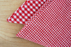 Chequered napkins on wooden table Stock Images