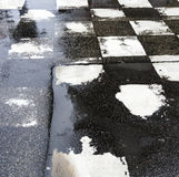 Chequered pattern painted on asphalt Stock Photography