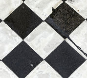 Chequered pattern painted on asphalt Stock Photo