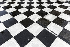 Chequered pattern painted on asphalt Stock Photos