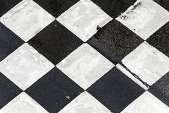 Chequered pattern painted on asphalt Stock Images