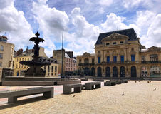 Cherbourg Town Square. In Normandy, France. Sunday afternoon quiet time. Fountain, town hall, benches and pigeons can be seen Royalty Free Stock Image