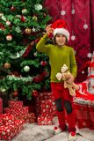 Cherful Christmas kid showing bauble royalty free stock photo