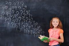 Cherful encoereged a menina da idade de escola primária Imagem de Stock Royalty Free