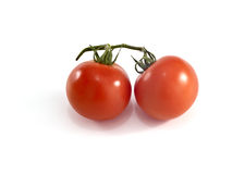 Cherie tomatoes on white bacground Royalty Free Stock Photography