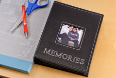 Cherished Memories. Photo Album Next To Photo Cutting Board Stock Photos