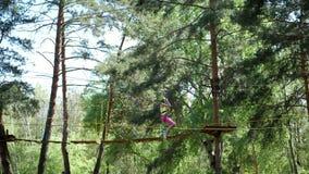 Cherkasa, Ukraine-May 1, 2018: pine city adventure park, Hanging rope bridges suspended between trees, Children in. Cherkasa, Ukraine-May 1, 2018: The visitors stock footage