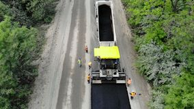 CHERKASSY REGION, UKRAINE - MAY 31, 2018: Aerial view on repair of a highway, the process of laying a new asphalt stock video