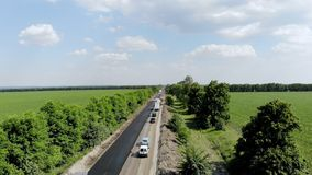 CHERKASSY REGION, UKRAINE - MAY 31, 2018: Aerial view on repair of a highway, the process of laying a new asphalt stock video footage