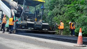 CHERKASSY REGION, UKRAINE - MAY 31, 2018: repair of a highway, Road construction works. workers lay asphalt. There are stock video