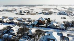 CHERKASY region, UKRAINA, GRUDZIEŃ 25, 2018: zima, śnieżyste ulicy, domy Mroźny słoneczny dzień aero, widok od zbiory