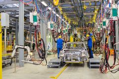 Cherkasy, Ukraine - June 17, 2013: The new production line for the assembly of of cars with modern equipment. Royalty Free Stock Photography