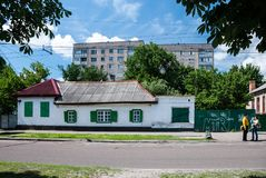 Cherkasy, Ukraine - June 02, 2013: old one-storey house. Old white one-storey house with green shutters. House in the center of Cherkassy, at the address stock image