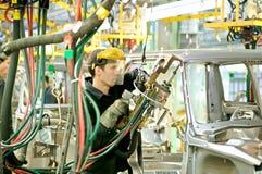 Cherkasy, Ukraine - May 29, 2012: Working welder at the plant for the production of cars. Cherkasy, Ukraine - May 29, 2012:Working welder at the plant for the Royalty Free Stock Photos
