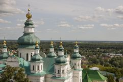 Chernigov, Ukraine. August 15, 2017. Christian orthodox white church with green domes and gold crosses. View from high. Calm sky. Above royalty free stock images