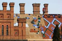 National University in Chernivtsi, Ukraine. Chernivtsi, Ukraine - December 21, 2017: Workers replace roof tiles on National University building, former residence royalty free stock photos