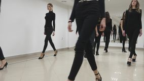 26.12.2017 Chernivtsi, Ukraine - Group of young girls trains defile in classroom in model school stock video