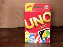 Chernivtsi, Ukraine - July 3, 2018:Uno game box. Very popular game in a box on a wooden background royalty free stock photos
