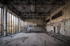Chernobyl - Abandoned basketball court. Abandoned basketball court in Pripyat - Chernobyl nuclear power plant zone of alienation Royalty Free Stock Images