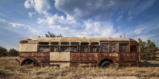 Chernobyl - Abandoned bus in a field Royalty Free Stock Images