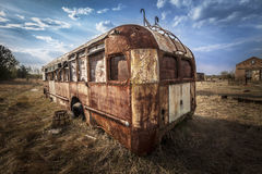 Chernobyl - Abandoned bus in a field Stock Images