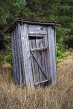 Chernobyl exclusion area. Small privy in abandoned Masheve settlement, Chernobyl Exclusion Zone, Ukraine Stock Image