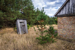 Chernobyl exclusion area. Small privy in deserted Masheve settlement, Chernobyl Exclusion Zone, Ukraine Royalty Free Stock Photography