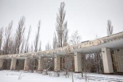 Chernobyl Exclusion Zone. CHERNOBYL REG, UKRAINE - Nov 29, 2016: Chernobyl Exclusion Zone. Lost city. Ruins of buildings in the abandoned city of Pripyat. Winter Royalty Free Stock Photo