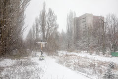 Chernobyl Exclusion Zone. CHERNOBYL REG, UKRAINE - Nov 29, 2016: Chernobyl Exclusion Zone. Snowfall in lost city. Crucifixion of Christ in the ghost town of Royalty Free Stock Photos