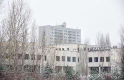 Chernobyl Exclusion Zone. CHERNOBYL REG, UKRAINE - Nov 29, 2016: Chernobyl Exclusion Zone. Snowfall in lost city. Ruins of buildings in the abandoned city of Royalty Free Stock Image