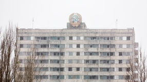 Chernobyl Exclusion Zone. CHERNOBYL REG, UKRAINE - Nov 29, 2016: Chernobyl Exclusion Zone. Snowfall in lost city. Ruins of buildings in the abandoned city of Stock Photos