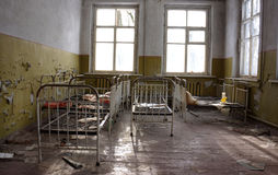 Chernobyl Kindergarten. Bed frames that were left behind in a kindergarten building inside the 10 km zone of the Chernobyl Region, Ukraine, after the disaster Royalty Free Stock Photos